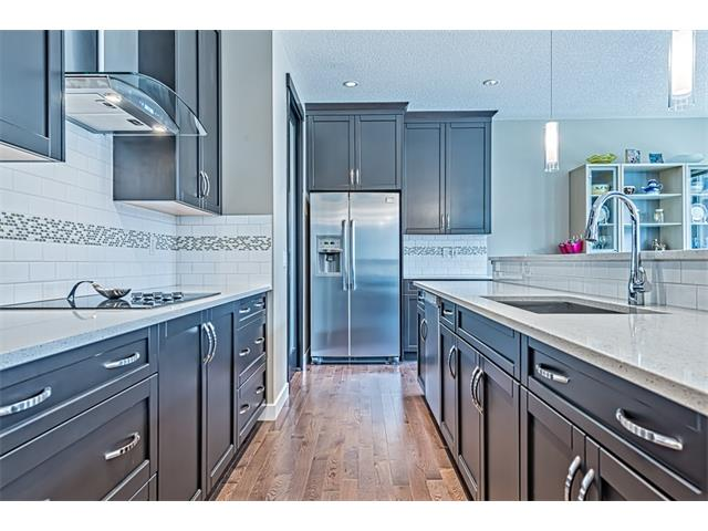 Sleek cabinets accented by high end stainless steel appliances.