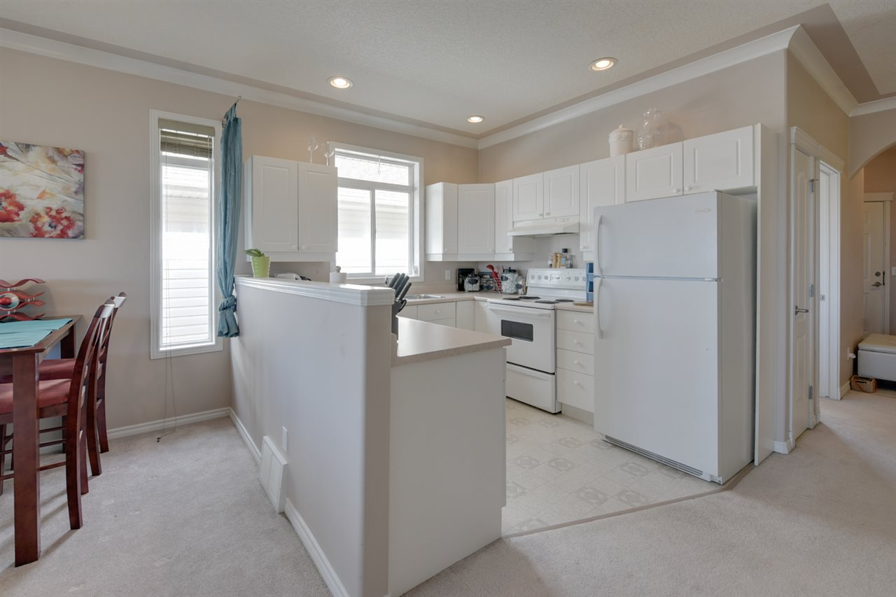 White cabinets, white appliances, lots of cupboard and counter space
