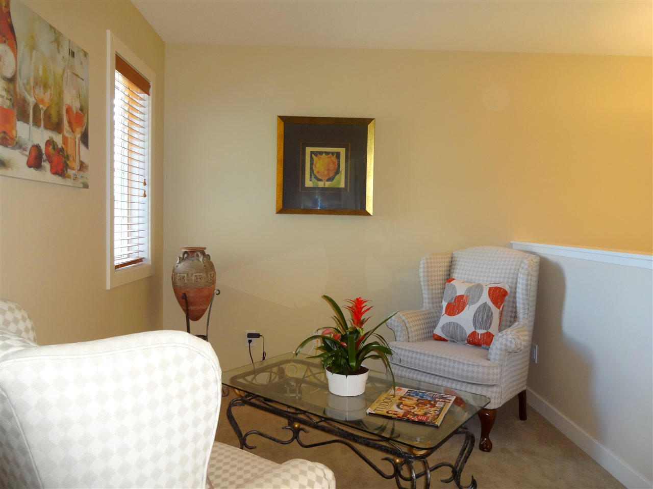 Cozy and Quiet....perfect area for relaxing or reading a book in this quaint loft on the upper level.