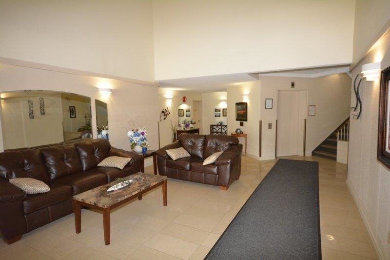 Your guests are welcomed into the building through a very well kept lobby area.  The suite is just a few doors away from the elevator.