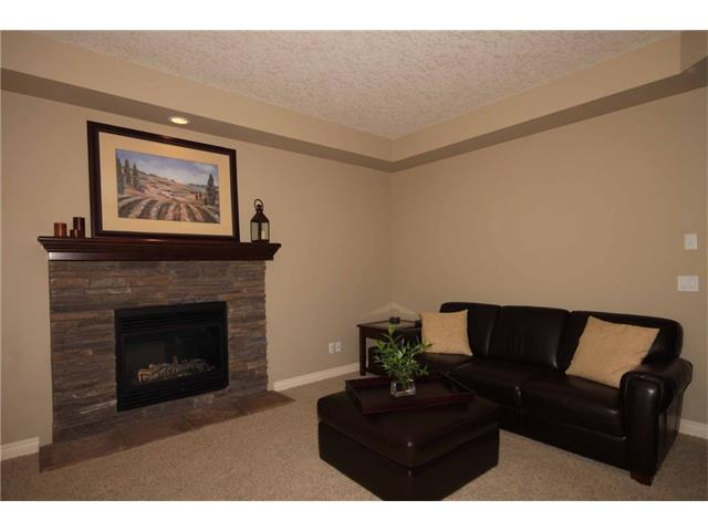 Photo 12: 136 Sunset Close: Cochrane House for sale : MLS® # C4044517