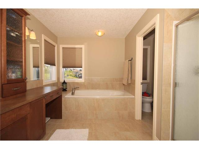 Master ensuite bathroom with soaker tub, separate shower and a large vanity.