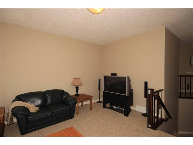Photo 25: 136 Sunset Close: Cochrane House for sale : MLS® # C4044517