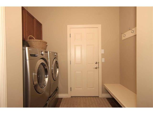 A spacious mud room and walk-through pantry. Stainless steel appliances and pedestals are included.