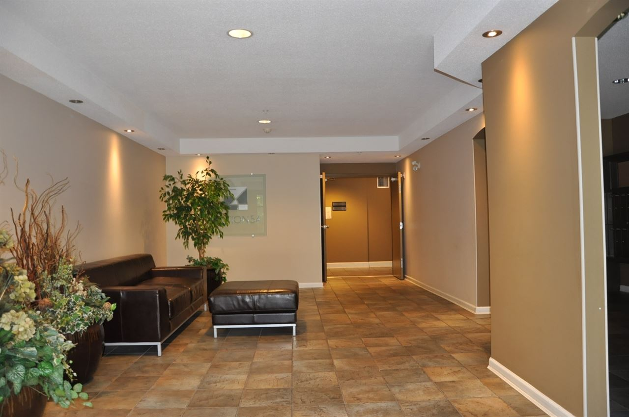 "Photo 2: 203 5465 203 Street in Langley: Langley City Condo for sale in ""STATION 54"" : MLS(r) # R2100862"