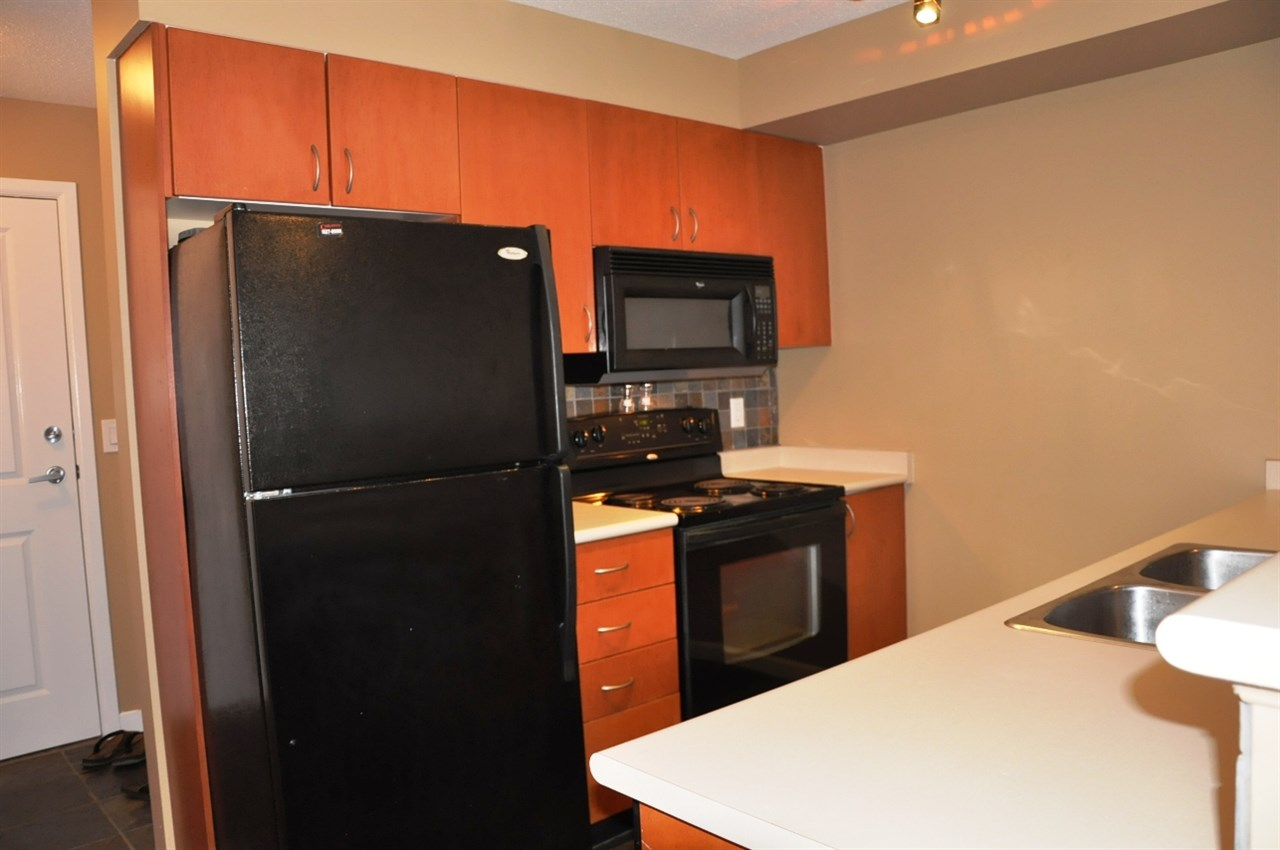"Photo 5: 203 5465 203 Street in Langley: Langley City Condo for sale in ""STATION 54"" : MLS(r) # R2100862"