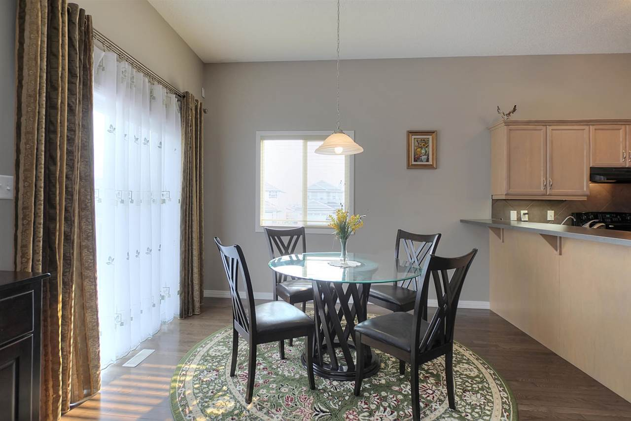 The breakfast nook is very bright and there is a patio door leading you to the deck.