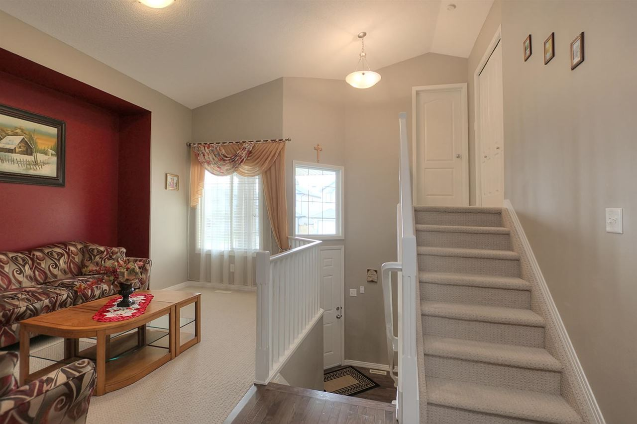 Open entrance with high ceilings. Formal living room at front of the house is great for entertaining.