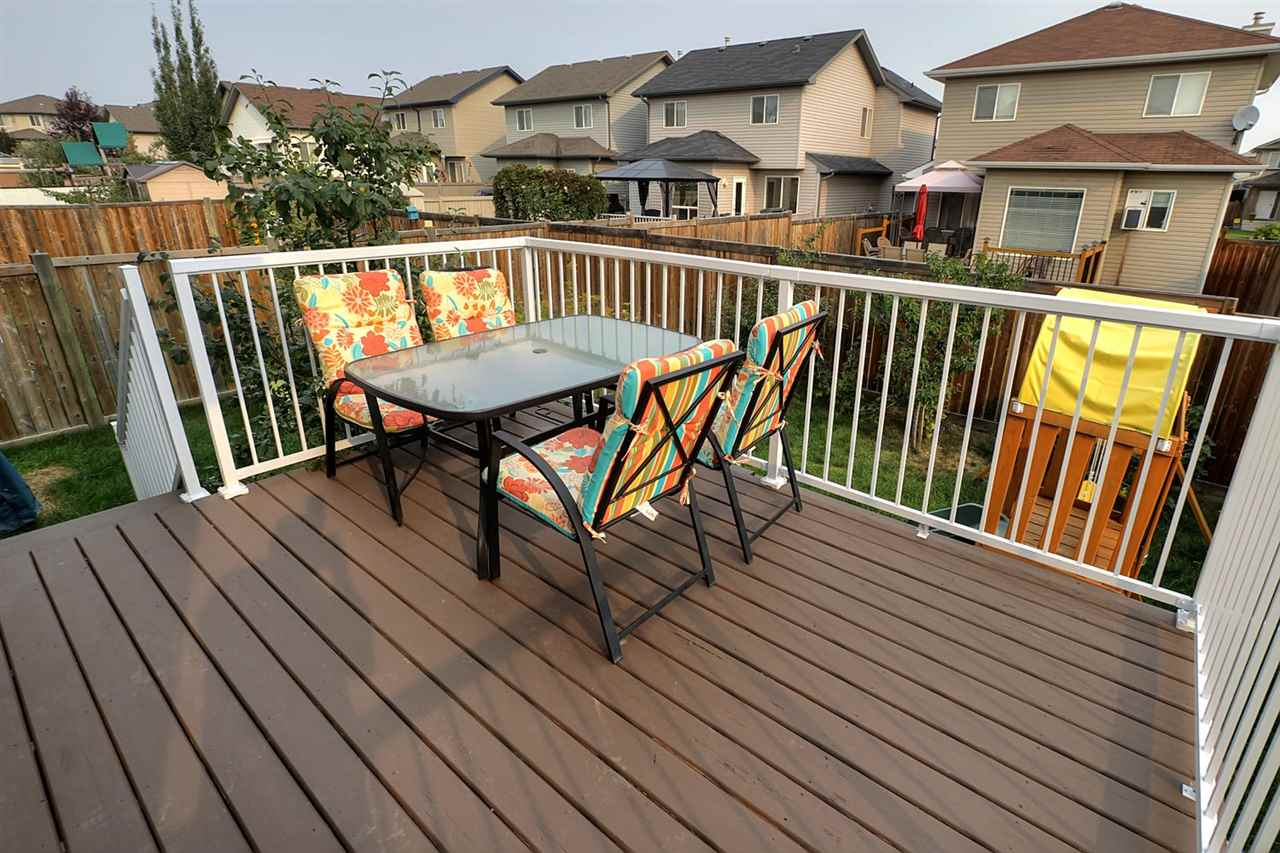 Deck has been recently painted and there is a  newer maintenance free railing.