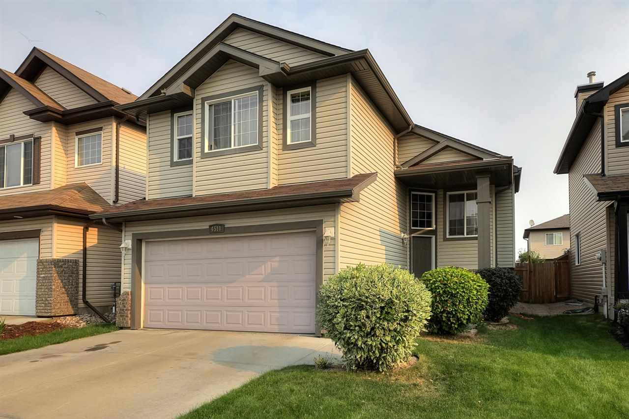 IMMACULATE & ELEGANT 1560 FT2 BI-LEVEL! Main floor kitchen, breakfast nook, large great room, formal dining & living rooms.