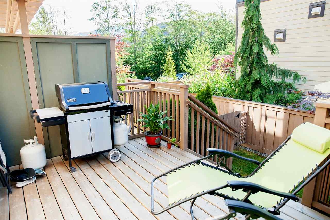 Oversized deck with lots of space for sunning and bbq-ing.