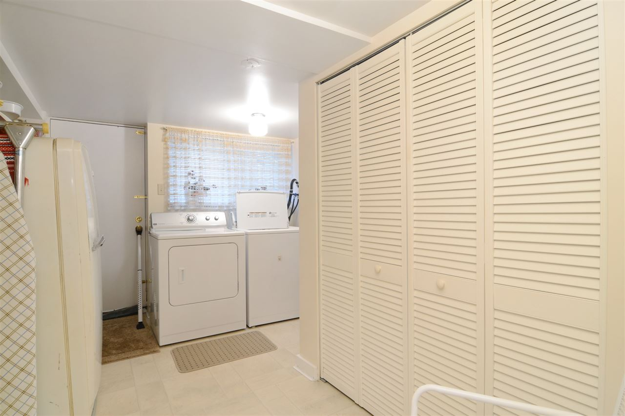 Large laundry room on lower level with access to outside.