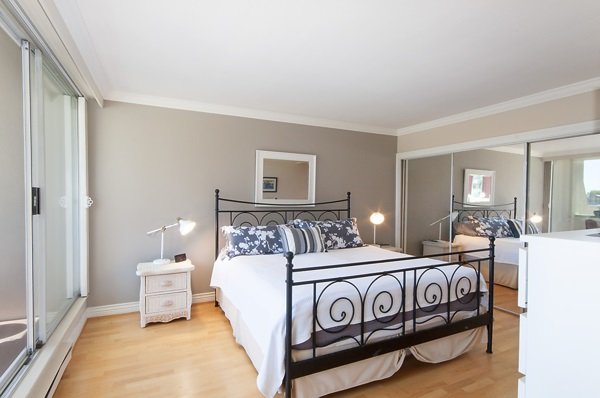 Large Master Bedroom, easily accommodates a King size bed, sliding doors out to a private patio.