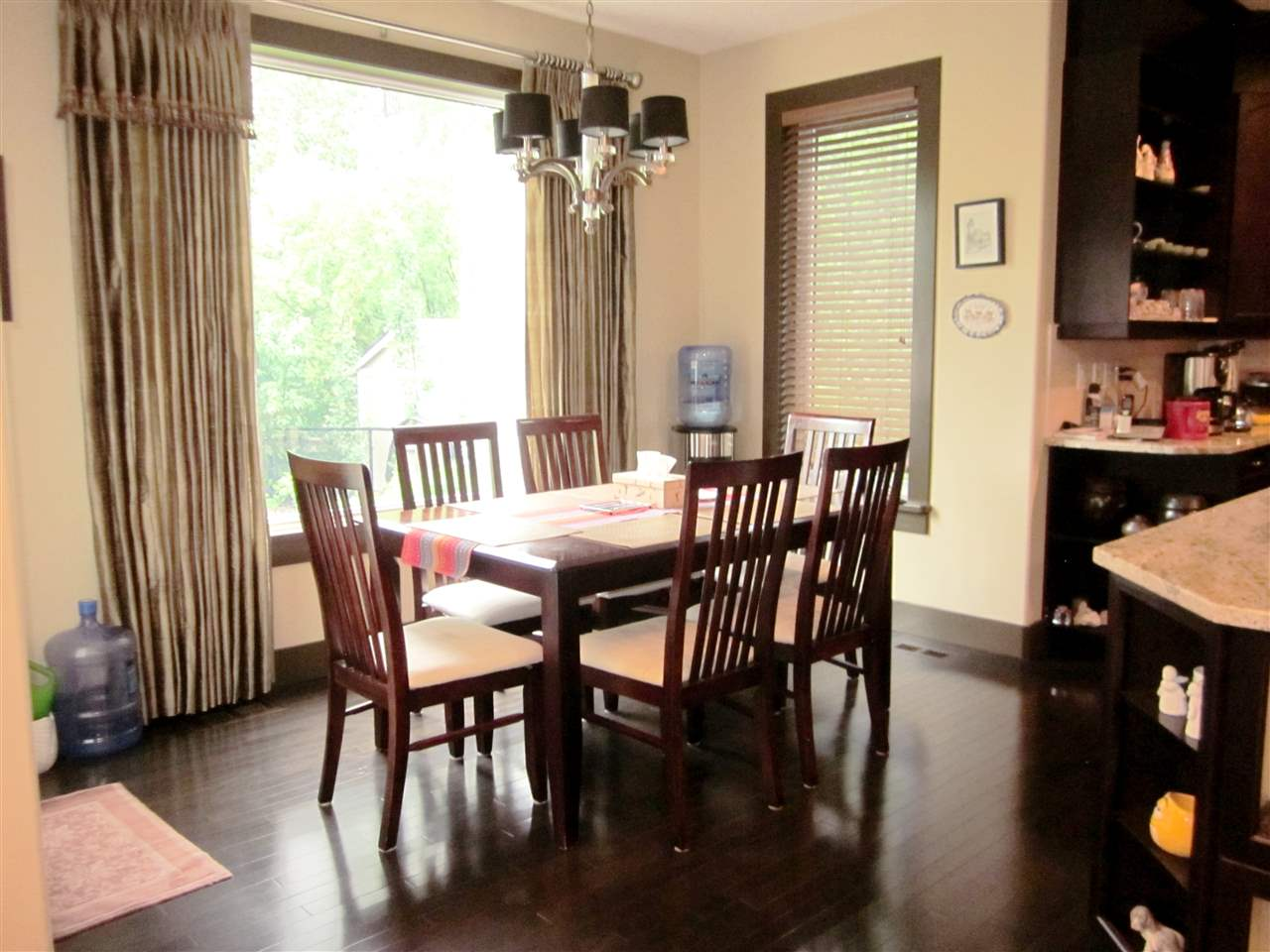 Breakfast nook has large window with view of the backyard, and garden door access to the deck.