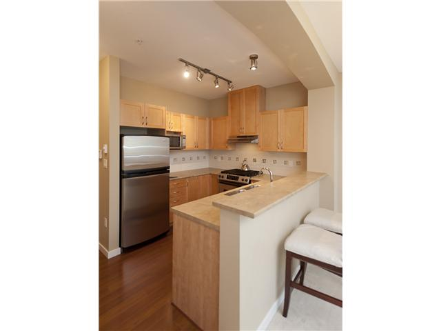 Photo 3: 108 2951 SILVER SPRINGS Boulevard in Coquitlam: Westwood Plateau Condo for sale : MLS(r) # V945866