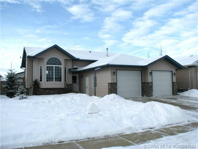 Main Photo: 11 Falcon Crescent in Sylvan Lake: SL Fox Run Residential for sale : MLS(r) # CA0007043