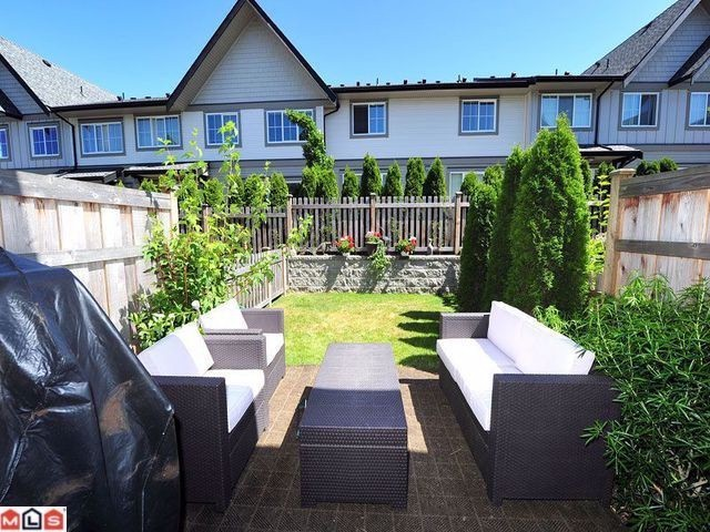 "Main Photo: 110 2501 161A Street in Surrey: Grandview Surrey Townhouse for sale in ""HIGHLAND"" (South Surrey White Rock)  : MLS® # F1304747"