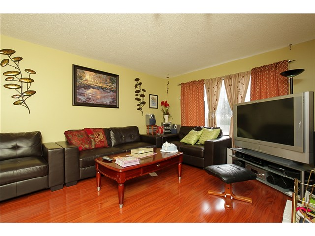 Photo 2: 7731 CANADA Way in Burnaby: Edmonds BE House for sale (Burnaby East)  : MLS® # V1075205