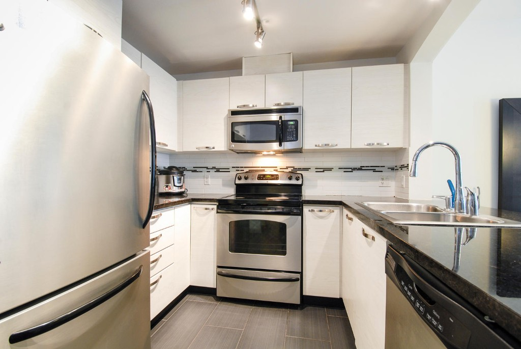 Photo 2: # 213 7428 BYRNEPARK WK in Burnaby: South Slope Condo for sale (Burnaby South)  : MLS(r) # V1050179