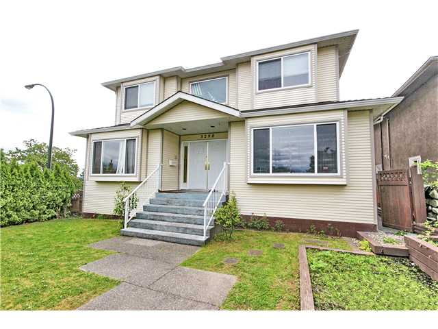 "Main Photo: 3298 E 2ND Avenue in Vancouver: Renfrew VE House for sale in ""FRASERVIEW"" (Vancouver East)  : MLS® # V1014619"