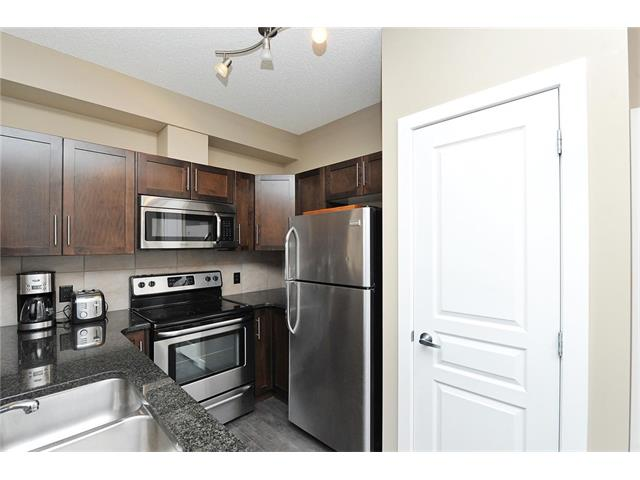 Photo 4: #104 22 PANATELLA RD NW in Calgary: Panorama Hills Condo for sale : MLS® # C4060846