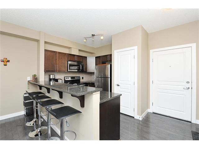 Photo 5: #104 22 PANATELLA RD NW in Calgary: Panorama Hills Condo for sale : MLS® # C4060846