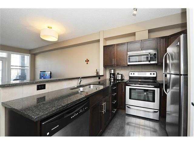 Main Photo: #104 22 PANATELLA RD NW in Calgary: Panorama Hills Condo for sale : MLS® # C4060846