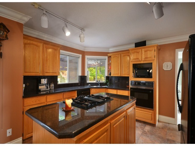 "Photo 3: 16437 77TH Avenue in Surrey: Fleetwood Tynehead House for sale in ""COAST MERIDIAN ESTATES"" : MLS® # F1306840"
