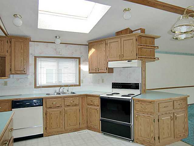 Photo 4: 142 ERIN WOODS Circle SE in CALGARY: Erinwoods Single Wide for sale (Calgary)  : MLS(r) # C3582049