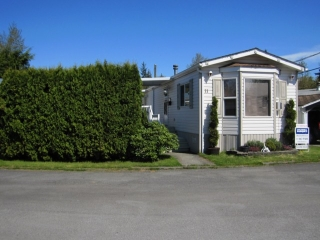 "Main Photo: 11 12868 229TH Street in Maple Ridge: East Central Manufactured Home for sale in ""ALOUETTE MOBILE HOME PARK"" : MLS®# V1002591"