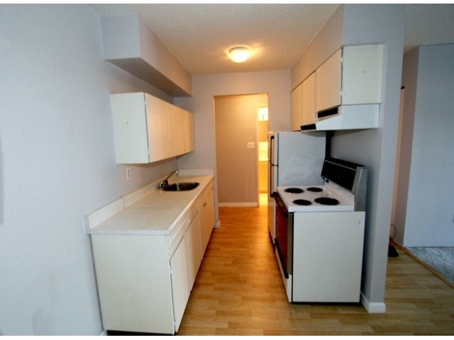 "Photo 2: # 203 11816 88TH AV in Delta: Annieville Condo for sale in ""Sungod Villa"" (N. Delta)  : MLS(r) # F1312271"