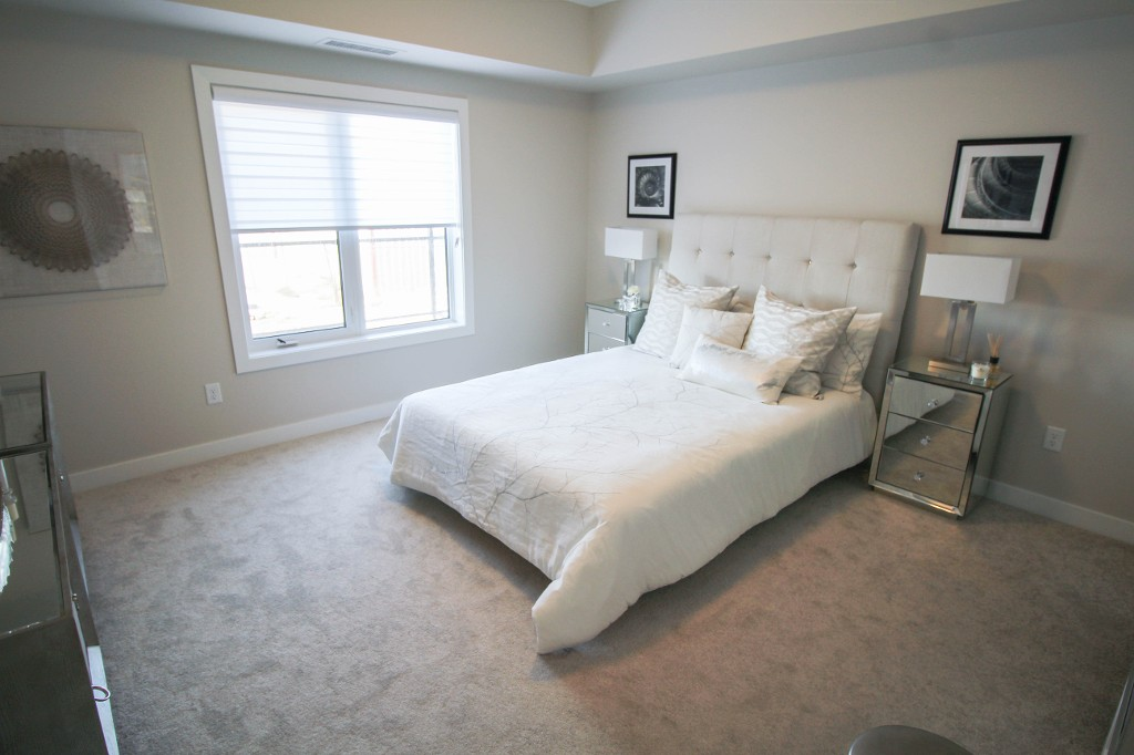 Spacious master bedroom with wall to wall carpeting.