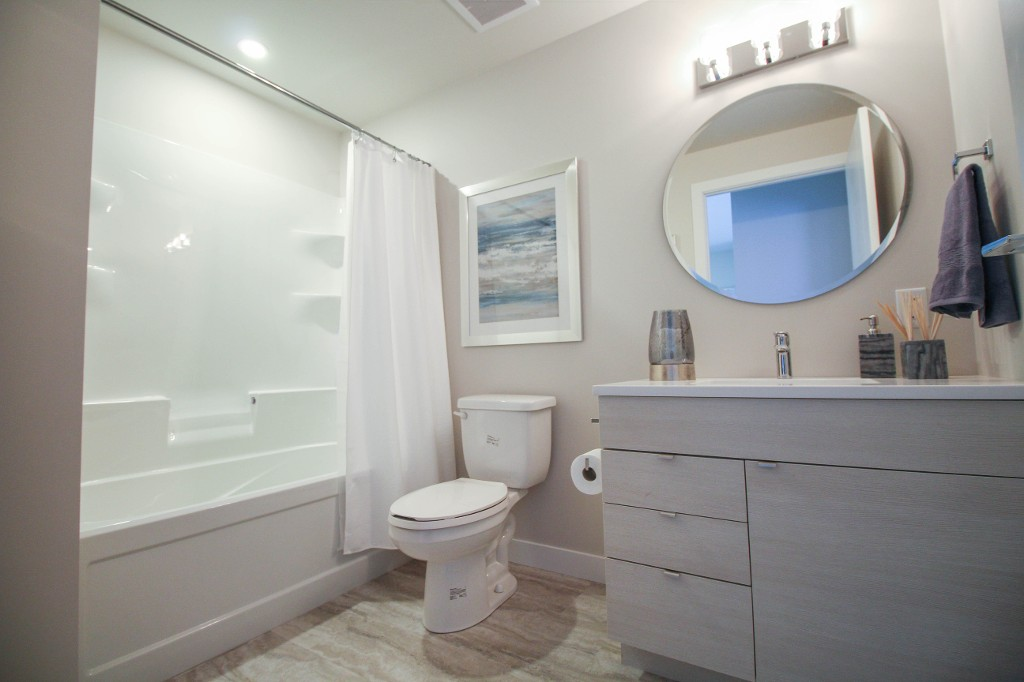 Nice size bathroom with one piece tub/shower.