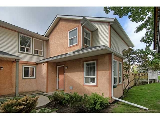 Main Photo: 103 SIGNAL HILL Green SW in CALGARY: Signature Parke Townhouse for sale (Calgary)  : MLS(r) # C3573943