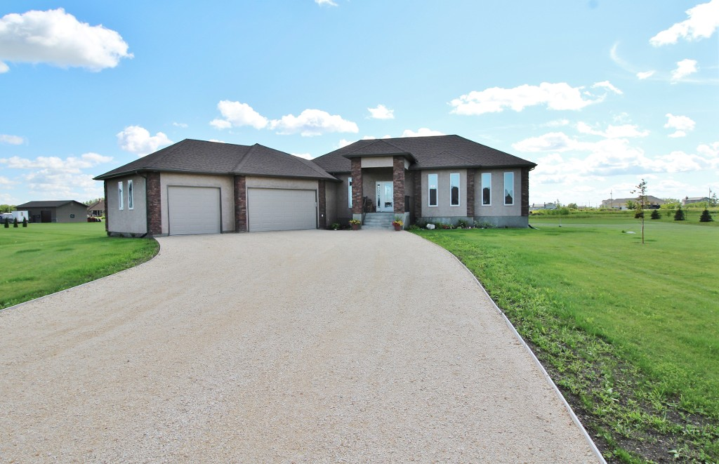 Gorgeous custom built bungalow with triple attached garage.
