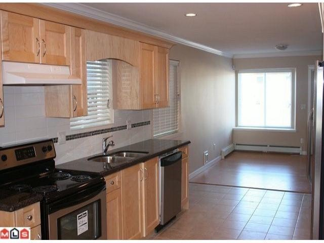 Photo 3: 9912 132 ST in Surrey: House Duplex for sale : MLS(r) # F1104140