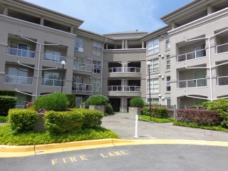 "Main Photo: 114 10533 UNIVERSITY Drive in Surrey: Whalley Condo for sale in ""Parkview Court"" (North Surrey)  : MLS® # F1313971"