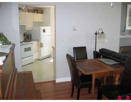 "Photo 5: 106 5765 GLOVER Road in Langley: Langley City Condo for sale in ""College Court"" : MLS® # F2712182"