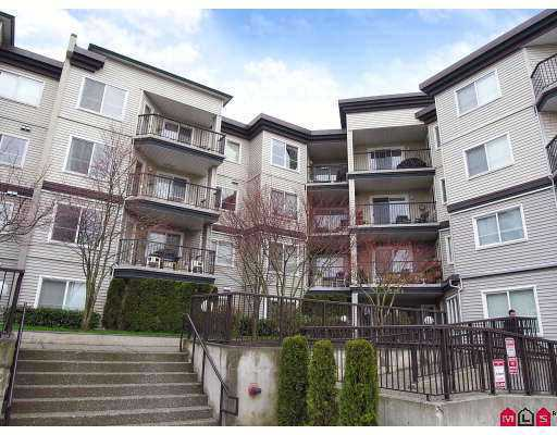 "Main Photo: 106 5765 GLOVER Road in Langley: Langley City Condo for sale in ""College Court"" : MLS® # F2712182"
