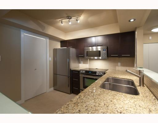 "Photo 1: 104 1265 W 11TH Avenue in Vancouver: Fairview VW Condo for sale in ""BENTLEY PLACE"" (Vancouver West)  : MLS® # V786392"