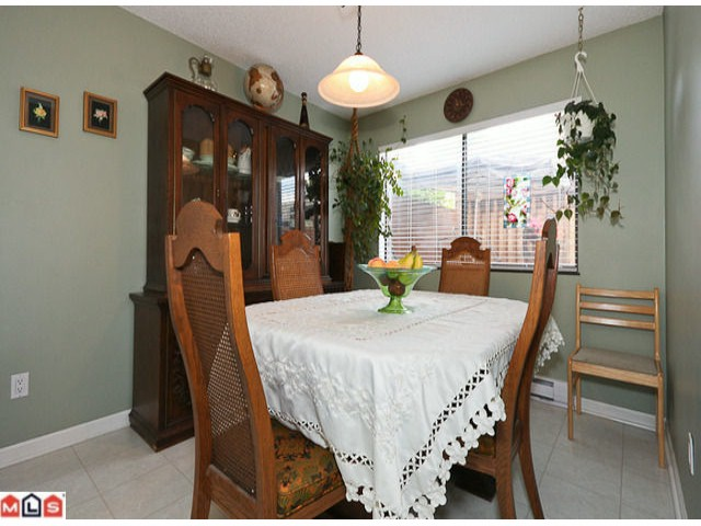 "Photo 3: 405 5074 201A Street in Langley: Langley City Townhouse for sale in ""NICOMEKL PLACE"" : MLS® # F1021981"