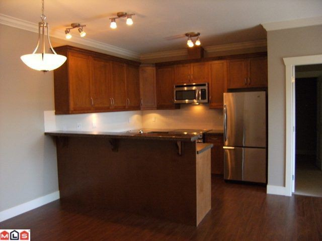 "Photo 4: 305 15368 17A Avenue in Surrey: King George Corridor Condo for sale in ""Ocean Wynde"" (South Surrey White Rock)  : MLS® # F1013160"