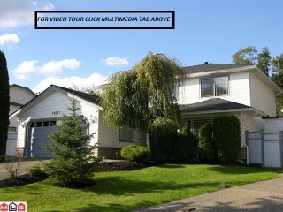 "Main Photo: 14657 84A Avenue in Surrey: Bear Creek Green Timbers House for sale in ""Chelsea Park"" : MLS® # F1022493"
