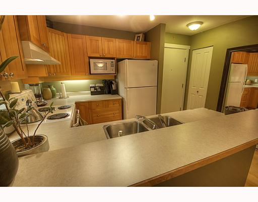 "Photo 2: 102 1420 PARKWAY Boulevard in Coquitlam: Westwood Plateau Condo for sale in ""THE MONTREAUX"" : MLS(r) # V792954"