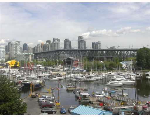 "Main Photo: 301 1490 PENNYFARTHING Drive in Vancouver: False Creek Condo for sale in ""HARBOUR COVE"" (Vancouver West)  : MLS®# V753639"