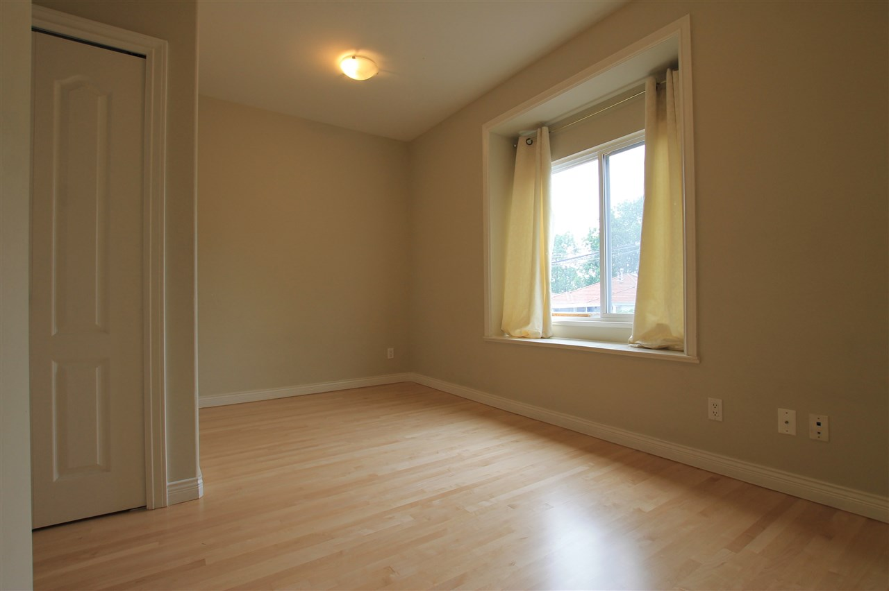 Large Master Bedroom with hardwood floors and walk-in closet