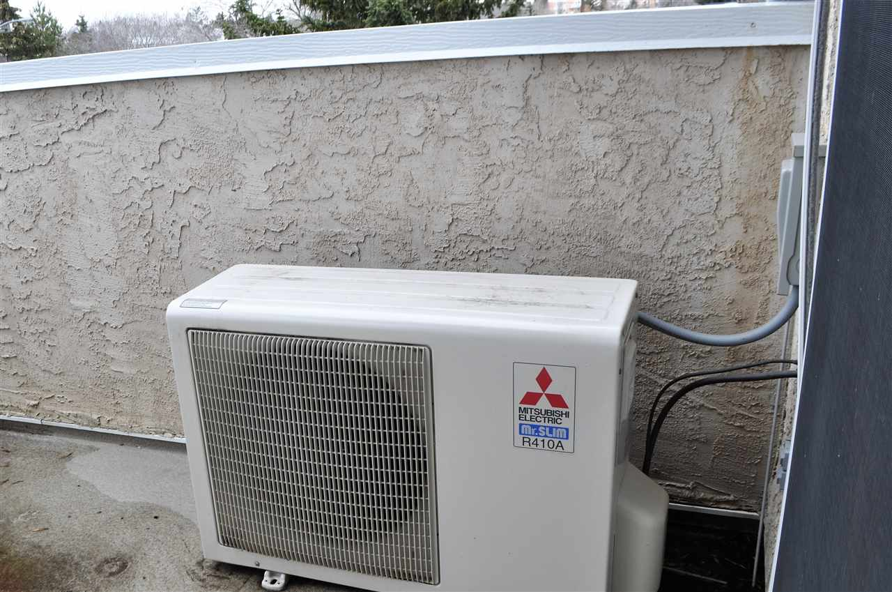 Central air conditioner unit for the open concept living room, dining room and kitchen.