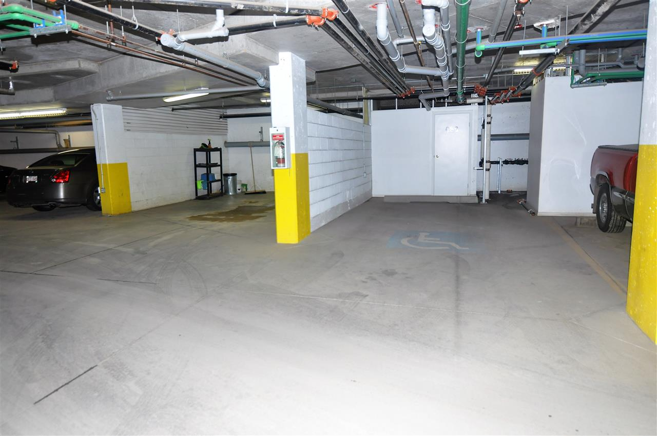 Oversize, extra wide parking stall with a storage locker.
