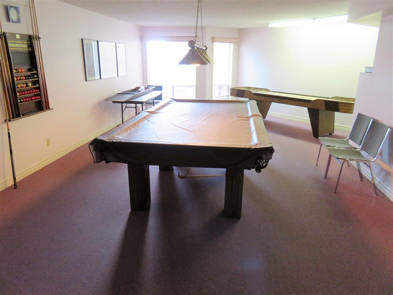 View of the Pool Table & Shuffle Board!