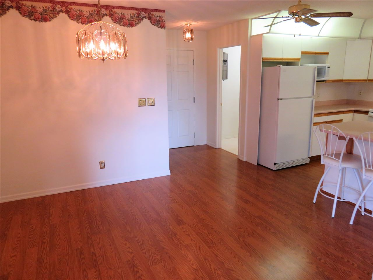 View of the whole Dining Room & Kitchen along with the front door & laundry room! :)